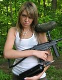 Teen lola topless with a paint gun