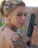 Sexy lette has a gun